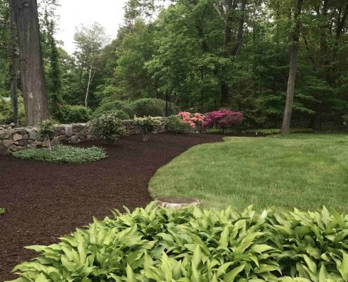 Mulching and retaining wall installation in Brookfield CT
